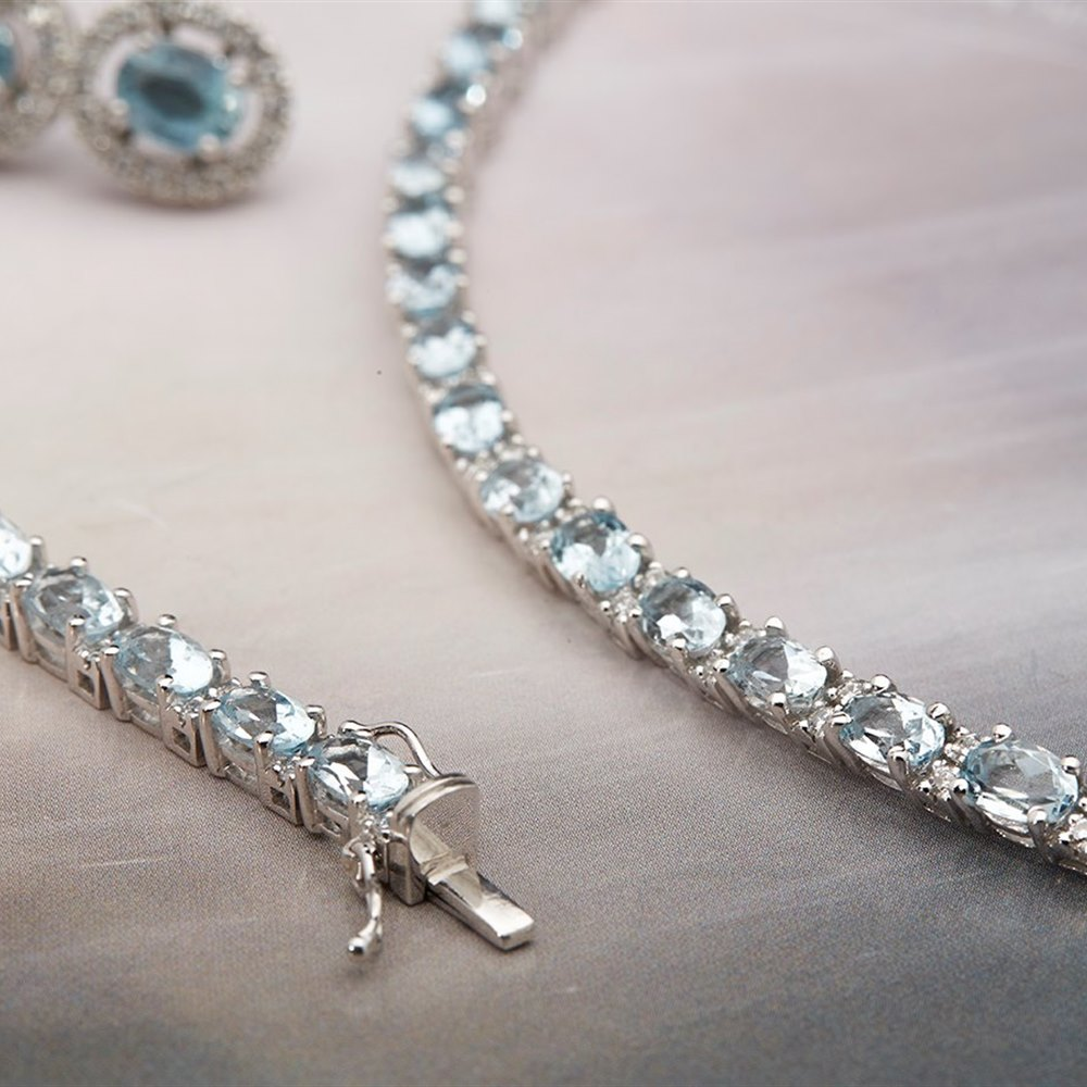 18k White Gold, total weight 69.9 grams  18k White Gold Aquamarine & Diamond Bracelet, Earrings & Necklace Suite