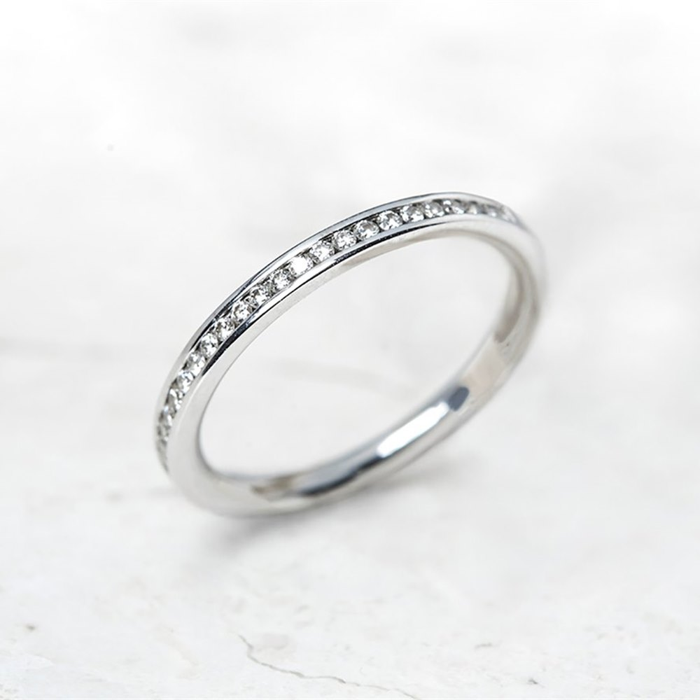 18k White Gold, total weight - 2.36 grams 18k White Gold 0.25ct Diamond Half Eternity Ring
