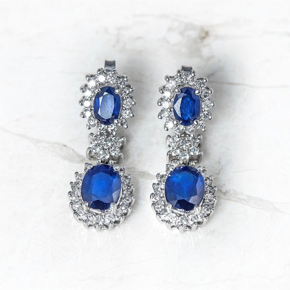 18k White Gold - total weight 7.43 grams 18k White Gold 5.60ct Sapphire & 1.20ct Diamond Drop Earrings