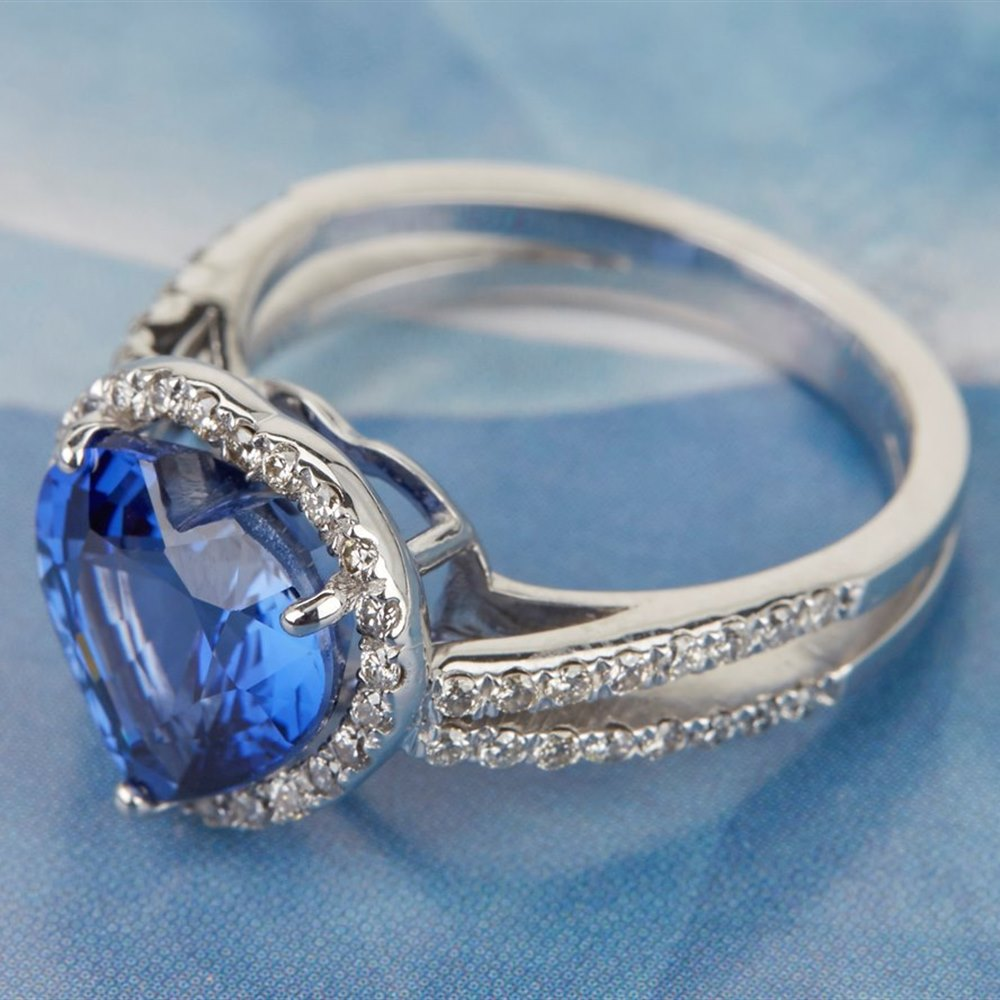 18k White Gold - 5.41 grams  18k White Gold Heart Cut 3.85ct Sapphire & 0.55ct Diamond Ring