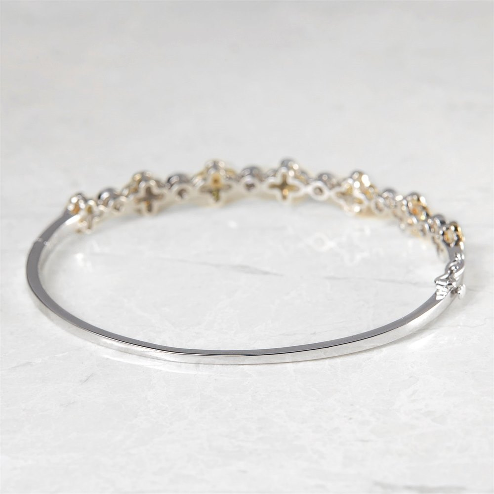 18k White Gold, total weight - 12.29 grams 18k White Gold Fancy Yellow Diamond Floral Bangle