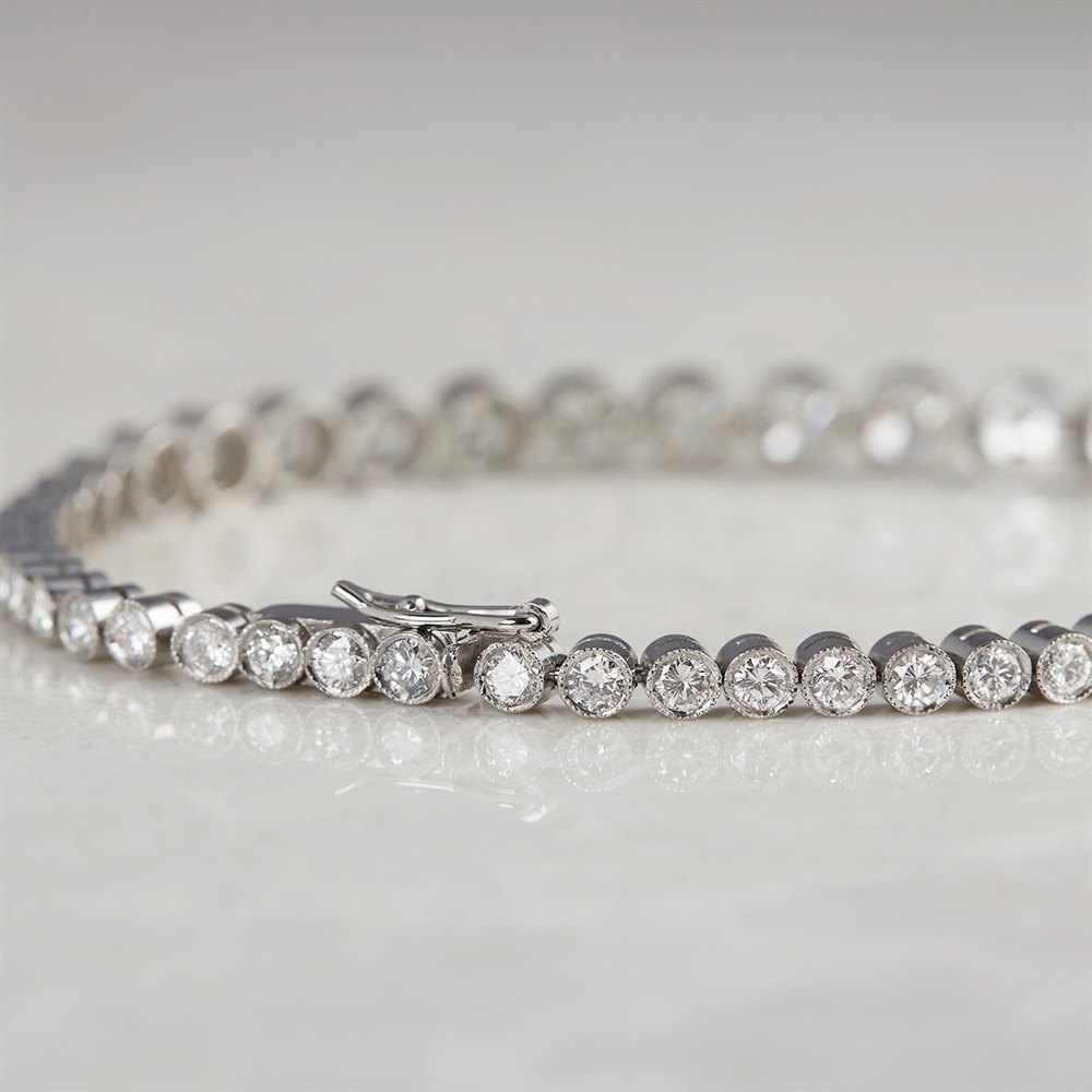 Platinum, total weight - 14.23 grams  Platinum 6.43ct Graduated Diamond Tennis Bracelet