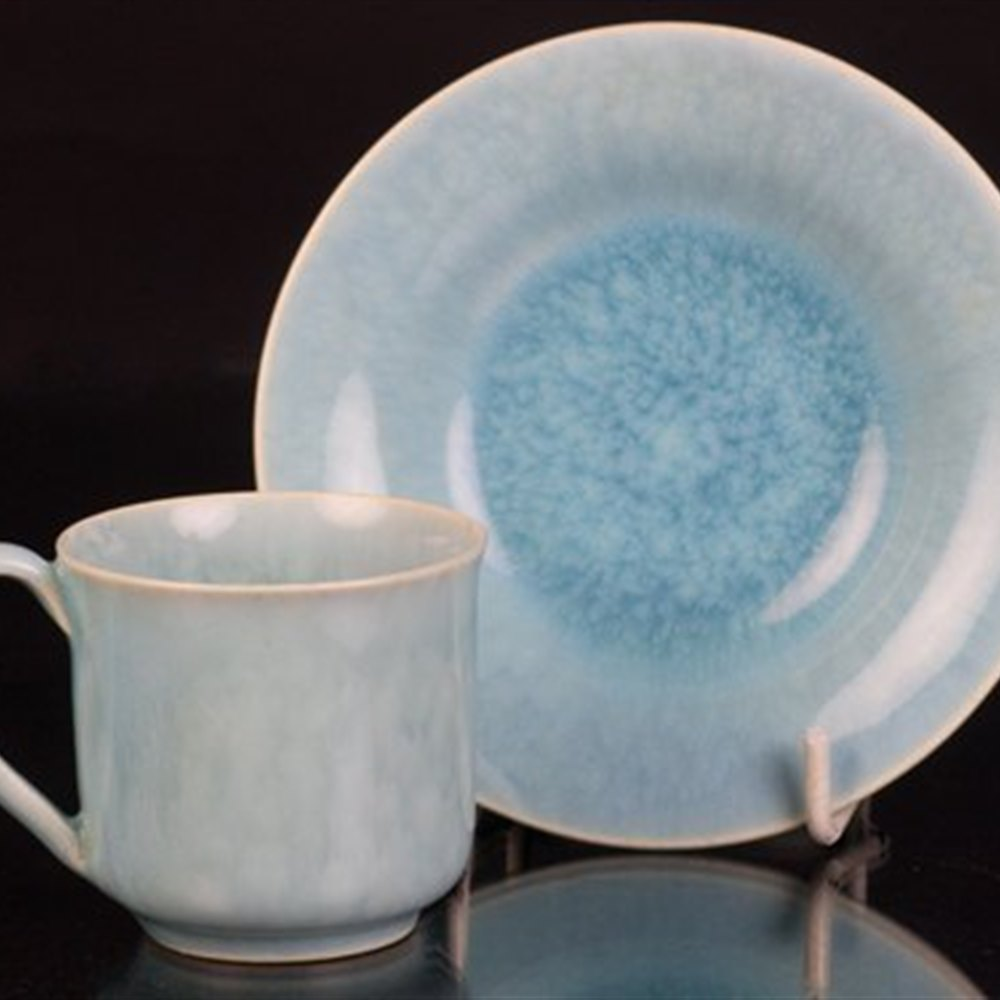 Ruskin Blue Glazed Cup & Sauce The cup and saucer date from the early 20th century