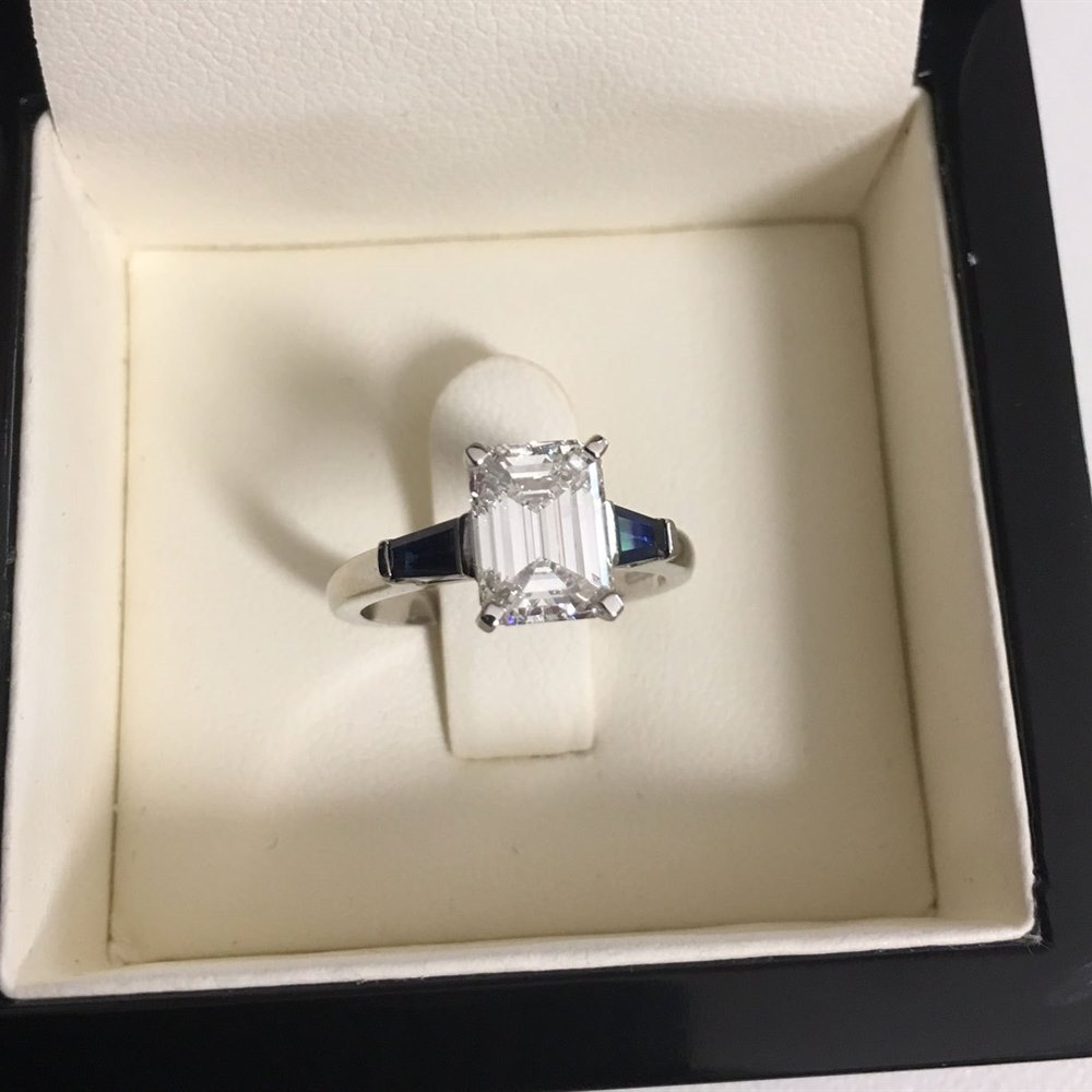 Platinum, total weight - 4.84 grams Platinum Emerald Cut 1.70ct F VVS1 Diamond & 0.44ct Sapphire Engagement Ring