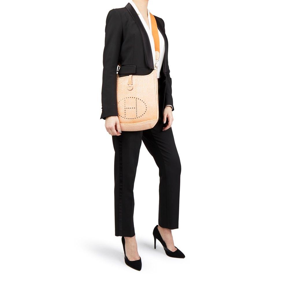 b289b588b14 Hermès Orange Dalmatian Buffalo Leather Evelyne I PM