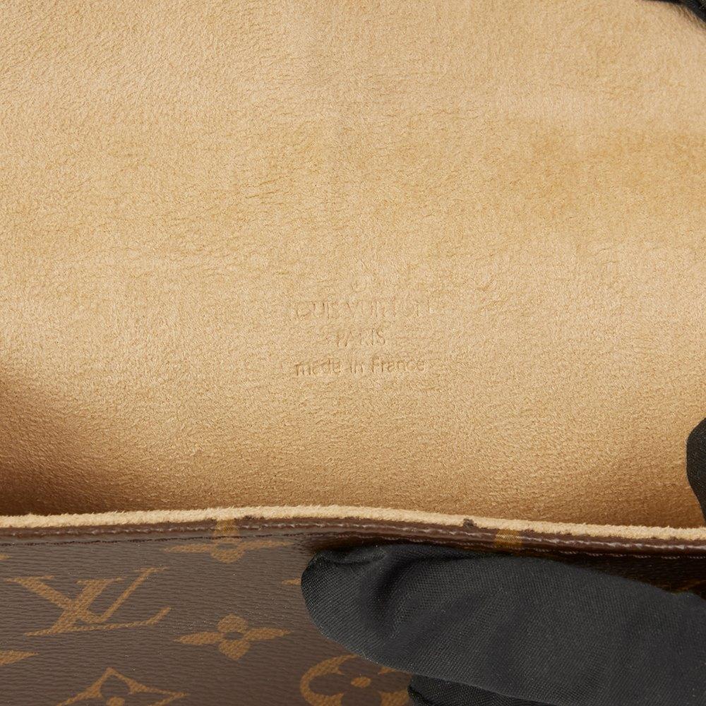 b3e391fa54aa Louis Vuitton Brown Coated Monogram Canvas Pochette Florentine