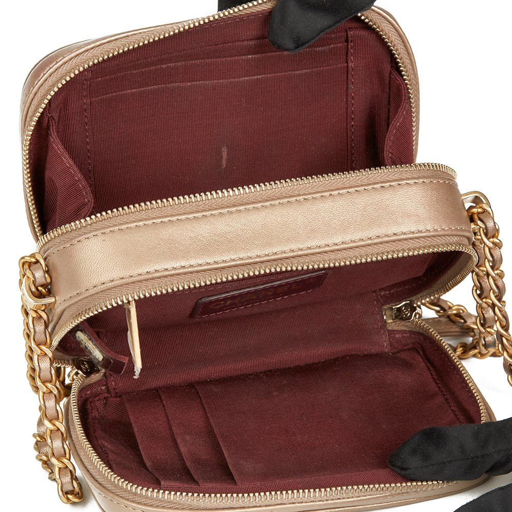 7124c7468efa Chanel Bronze Quilted Lambskin Small Coco Boy Camera Case Bag