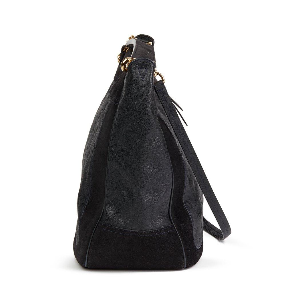 6233a2d2dcc0 Louis Vuitton Black Monogram Empreinte Leather   Suede Audacieuse Bag