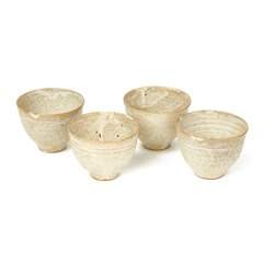 FOUR STUDIO POTTERY OATMEAL GLAZED BOWLS 20TH C.