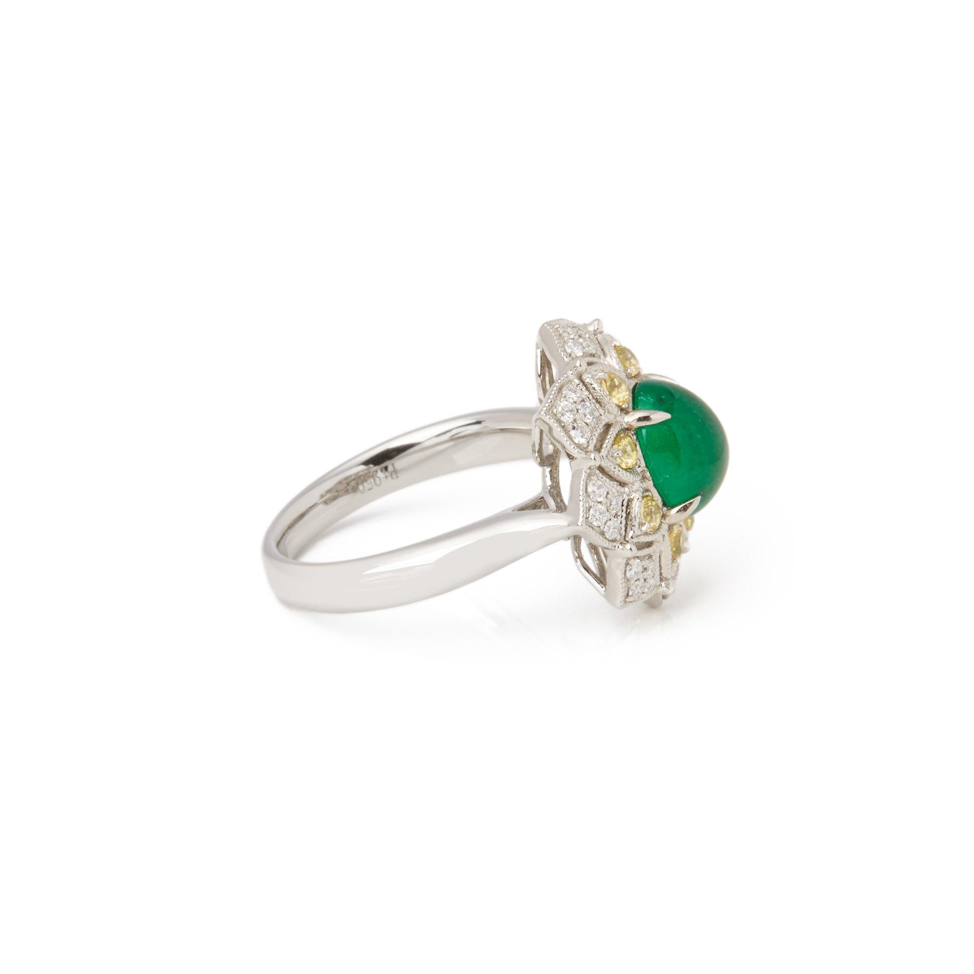 David Jerome Platinum Emerald, Diamond and yellow Sapphire Cluster Ring
