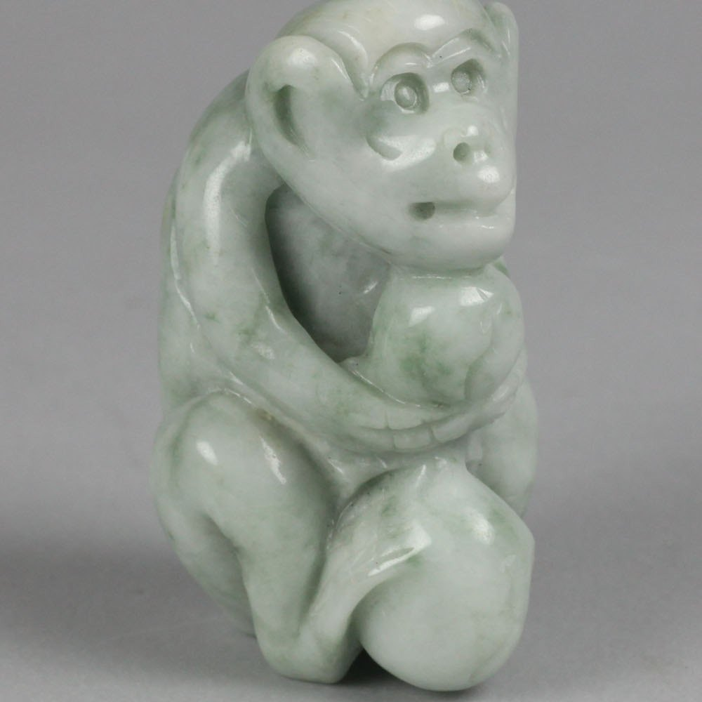 CARVED JADE FIGURE OF A MONKEY 19th or early 20th Century