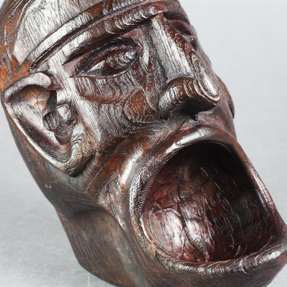 OAK GROTESQUE FOLKART HEAD Believed to date to the 19th or early 20th century