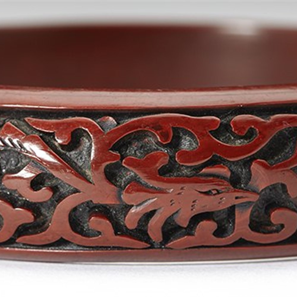 CINNABAR LAQUER BANGLE Believed to date from the early 20th century but possibly earlier