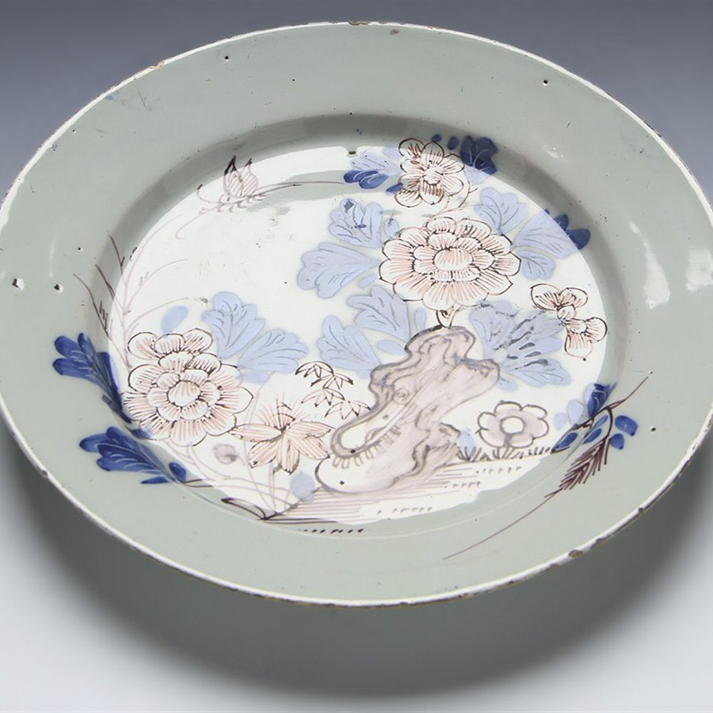 STYLISH ANTIQUE ENGLISH DELFT PLATE WITH INSECT IN FLORAL ROCK GARDEN 18TH C.