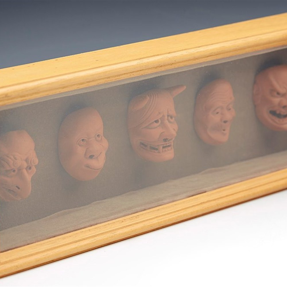 FRAMED SET VINTAGE JAPANESE MINIATURE NOH TERRACOTTA MASKS 20TH C. Dates from the 20th century