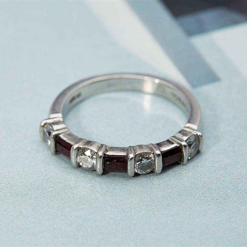 Tiffany Platinum Brilliant Cut Diamond & Emerald Cut Ruby ring (ruby's 0.45cts + Diamonds 0.80cts)
